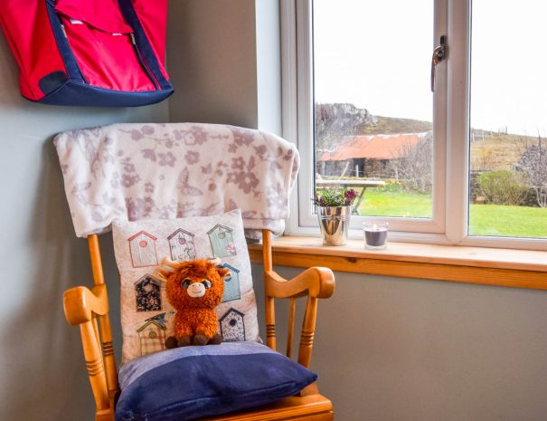 Relax in the rocking chair in our sun porch at Gables Cottage, Wester Ross